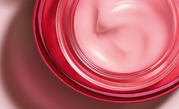 Open jar of Rose Radiance Cream shot from above, showing pink-tinted cream inside