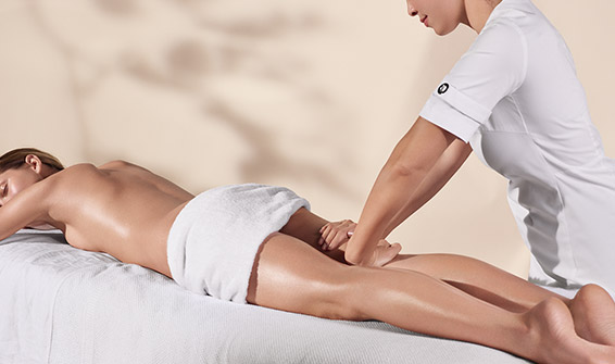 Clarins aesthetician providing a body treatment