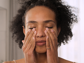 woman touching the area around her eyes